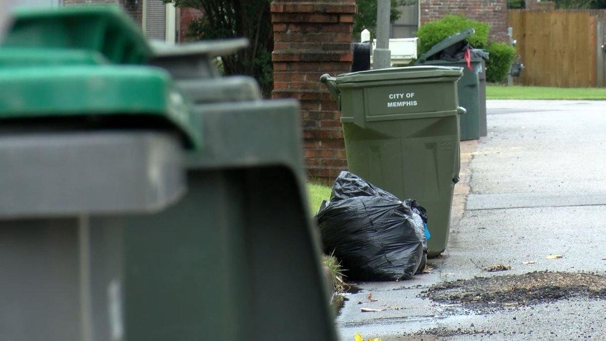 Trash bins line a street in Memphis, Tennessee June 22, 2020.