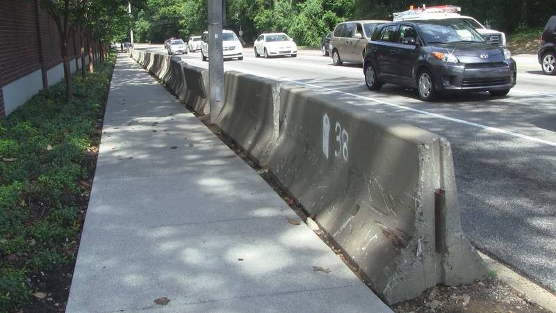Concrete barriers line Poplar Avenue near East Parkway. City crews could soon impound the...