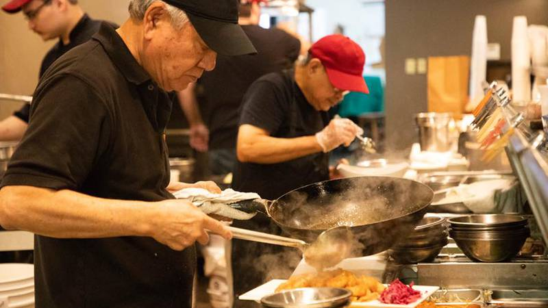 Eddie Pao cooking at his Memphis-based restaurant, Mosa Asian Bistro