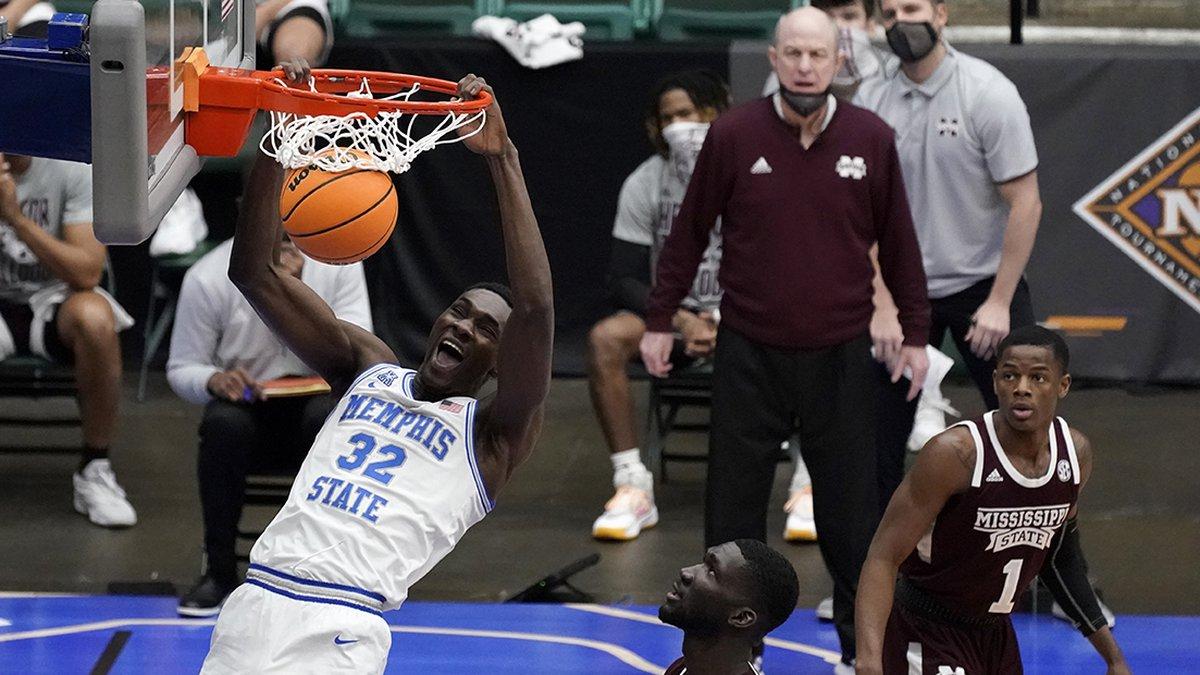 Memphis center Moussa Cisse (32) dunks the ball as Mississippi State forward Abdul Ado, center,...