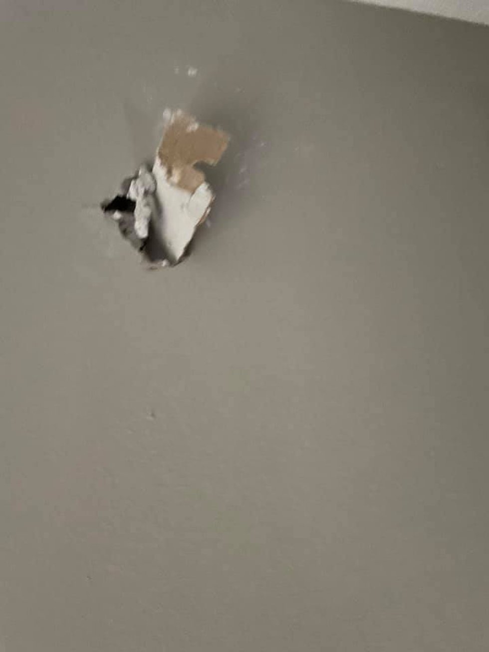 Nails and other debris flew into a wall across the room when lightning struck a home in Wynne,...